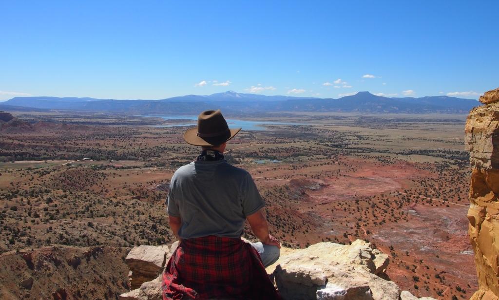 Sitting by Chimney Rock overlooking Pedernal Mesa.