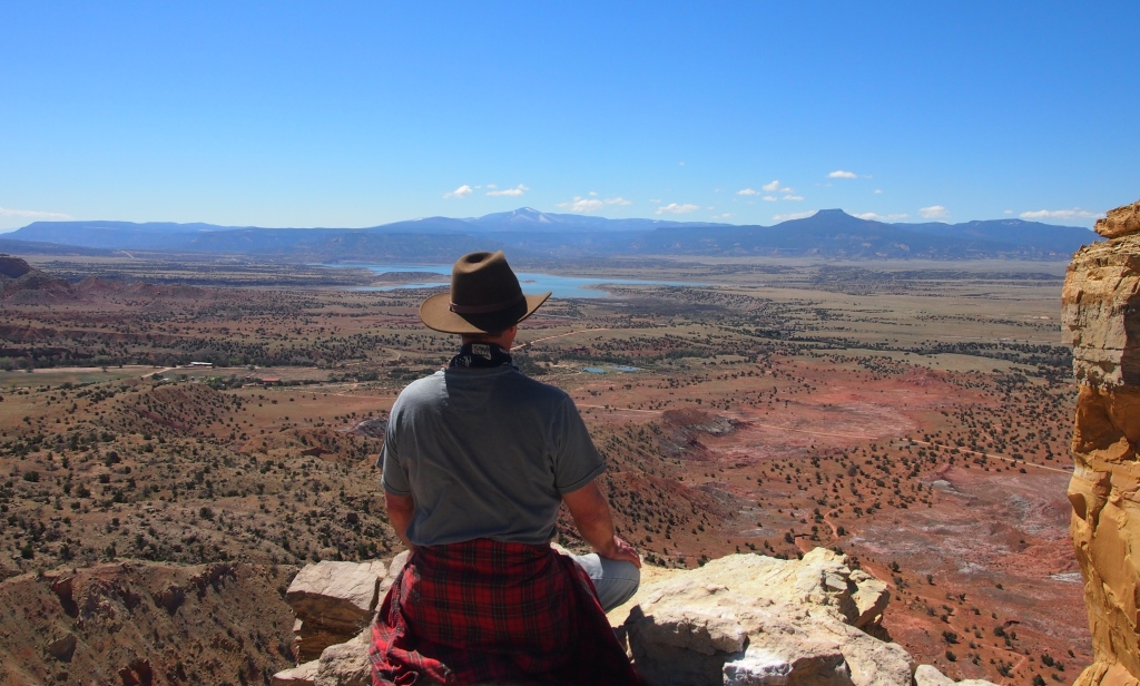 Sitting by Chimney Rock overlooking Pedernal Mesa.